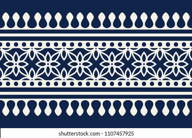 Woodblock printed indigo dye seamless ethnic floral border. Traditional oriental ornament of India Kashmir, geometric flowers motif, ecru on navy blue background. Textile design.