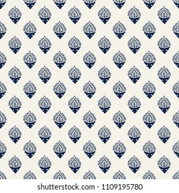 Woodblock printed indigo dye seamless ethnic floral all over pattern. Traditional oriental ornament of India, elegant flowers of Kashmir, navy blue on ecru background. Textile design.