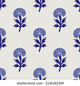 Woodblock printed indigo dye seamless ethnic floral all over pattern. Traditional oriental motif of India, flowers of Rajasthan, with blue marigolds on ecru background. Textile design.