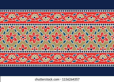 Woodblock printed indigo dye seamless ethnic floral border. Traditional oriental ornament of India, garland motif with primitive red and gold flowers on navy blue background. Textile design.