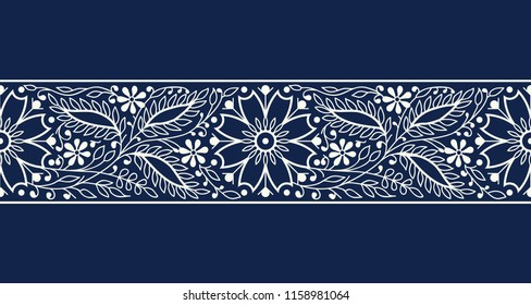 Woodblock printed indigo dye seamless ethnic floral border. Traditional oriental ornament of India, elegant flowers and leaves, ecru on navy blue background. Textile design.