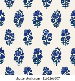 Woodblock printed indigo dye seamless ethnic floral all over pattern. Traditional oriental motif of India with carnations, blue shades on ecru background. Textile design.