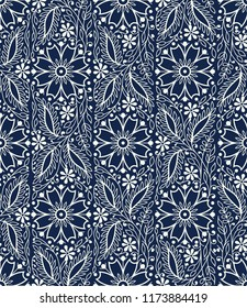 Woodblock printed indigo dye seamless ethnic floral pattern. Traditional oriental wave ornament of India, elegant flowers and leaves, ecru on navy blue background. Textile design.