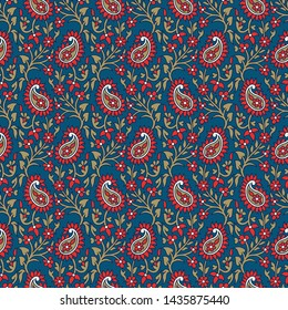 Woodblock printed indigo dye seamless ethnic floral pattern. Traditional oriental ornament of India, all over paisley motif, red and golden on blue background. Textile design.