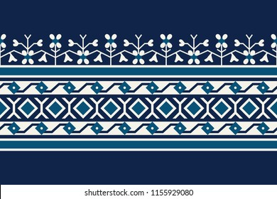 Woodblock printed seamless indigo dye ethnic floral border. Traditional oriental ornament of India , geometric floral motif, meander and diamond pattern, ecru and teal on navy blue background. Textile