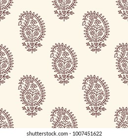 Woodblock printed seamless paisley pattern. Traditional oriental ethnic ornament of India, brown on ecru background. Textile design.