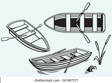 Wooden boat with paddles isolated on blue background