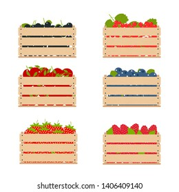 Wooden boxes with fruits collected from the farm. Packed organic fruits
