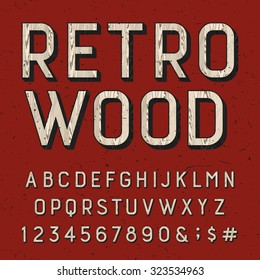 Wooden retro alphabet font. Sans serif type letters, numbers and symbols on the red distressed background. Vintage vector typography for labels, headlines, posters etc.