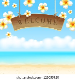 The wooden signboard Welcome hangs against tropical flowers and sea shore