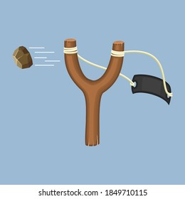 Wooden slingshot with flying stone isolated on a blue background. Homemade slingshot wooden handle with rubber bands. Wooden catapult. Children toy for throwing stones. Vector illustartion