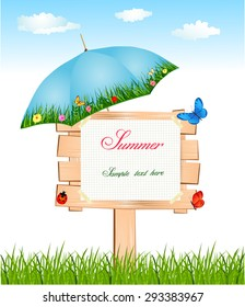 Wooden summer signboard with umbrella and butterflies between grass and sky