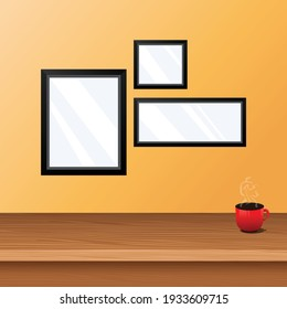 wooden table top with empty space and coffee tea on top and yellow wall with modern frames to add logo and posters for a graphic project. can be used for any interior presentation or video or cafe
