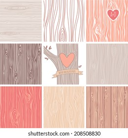 Woodgrain, wooden texture background and a carved heart in a tree, perfect as wedding backgrounds and valentines day cards