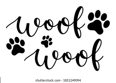 Woof word with paw marks hand drawn lettering ink in black vector illustration. Brush calligraphy isolated on white background for design purposes.