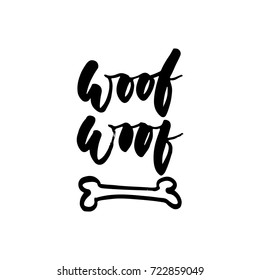 Woof-woof - Symbol of the year 2018 Dog hand drawn lettering quote isolated on the white background. Fun brush ink inscription for greeting card or t-shirt print