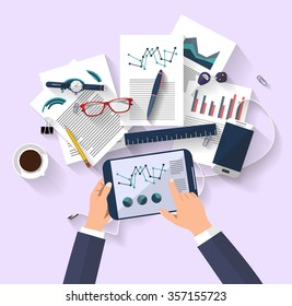 work concept - business concept - flat design - top view - digital tablet show a graphs of business change - set of paper that have a graphs and reports - desktop that contains a set of items - ideas