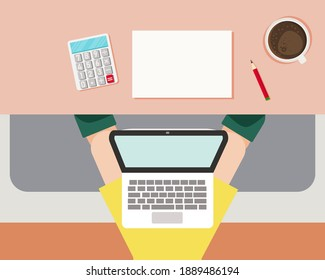 Work from home concept: There are man sitting on his sofa with laptop, coffee, calculator, paper, pencil at his home.