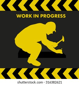WORK IN PROGRESS sign with worker silhouette with hammer and nail