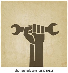 worker hand with wrench symbol old background - vector illustration. eps 10