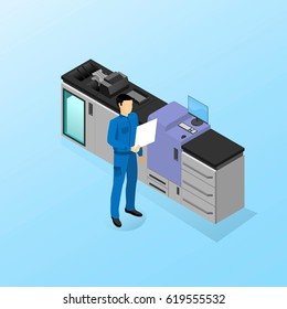 The worker is standing near the machine for digital printing