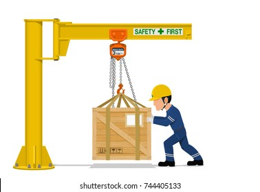 A worker is using the jib crane to handling the heavy wooden container on transparent background