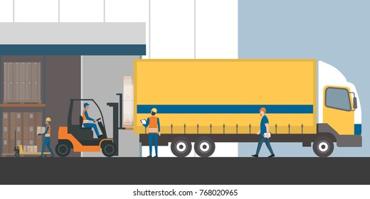 Workers loading the truck with packed goods at the industrial warehouse with a forklift truck: freight transportation, shipment and logistics