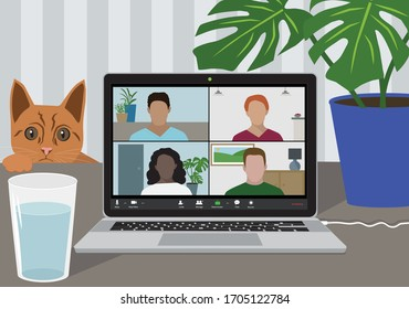 Working from home during Covid-19 pandemic. Video conference call using an app like Zoom during lockdown. Social isolation due to coronavirus. Cat watching video meeting.