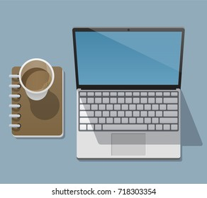 Working laptop with an open screen, disposable coffee cup and notepad is on a flat surface and casts a shadows on it. View from above. Vector illustration in a trendy flat style