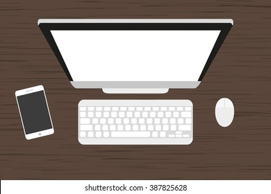 Workplace  at a wooden table. Monitor, keyboard, computer mouse and smartphone
