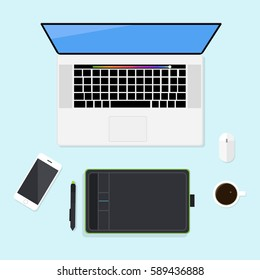 Workspace with laptop Macbook, computer mouse, graphics tablet Wacom Bamboo and stylus, smartphone iPhone and coffee cup. Desktop top view on blue background. Flat design. Vector illustration