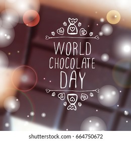 World chocolate day handlettering elements with doodle heart shaped chocolate candies on blurred background