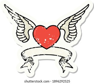 worn old sticker with banner of a heart with wings