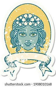 worn old sticker with banner of a maiden with crown of flowers