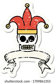 worn old sticker with banner of a skull jester