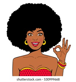 Wow comic face. Sexy surprised young african woman with open mouth and afro hairstyle in glasses shows OK sign. Vector hand drawn colorful character in comic style isolated on white background.