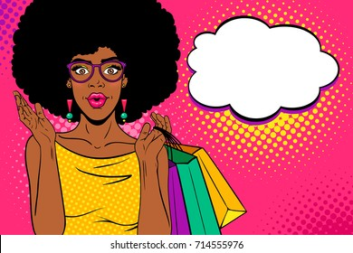 Wow female face. Sexy surprised african american black woman with open mouth and afro hair holding shopping bags in her hand and speech bubble. Vector bright background in pop art retro comic style.