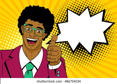 Wow pop art man. Happy young surprised african man in glasses and suit shows thumb up with open mouth, afro hairstyle and speech bubble. Vector cartoon background in pop art retro comic style.