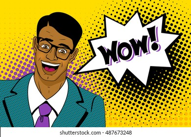 Wow pop art man. Happy young handsome surprised  man in glasses and suit with open mouth, with dark skin and speech bubble. Vector colorful cartoon background in retro comic style.