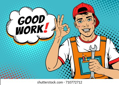 Wow pop art worker face. Young handsome man in coveralls and baseball cap smiles, shows okay sign, holds wrench and Good work! speech bubble. Vector illustration in retro comic pop art  style.