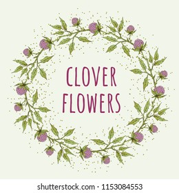 Wreath of herbal pink clover flowers on light background