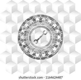 wrench icon inside grey icon or emblem with geometric cube white background