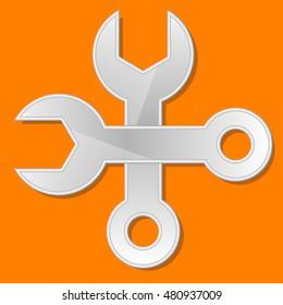 Wrench on orange background