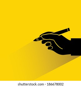 writing yellow background, hand holding pen