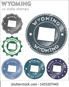 Wyoming stamps collection. Rubber stamps with us state map silhouette. Vector set of Wyoming logo.