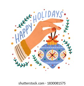 Xmas greeting card decorated with confetti, bauble and branches of mistletoe. Female hand decorating or holding christmas tree decoration. Vector flat cartoon illustration isolated on white