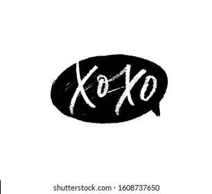 Xo Xo phrase for Valentine's day. Hand drawn vector brush calligraphy. Black grunge speech bubble. Ink illustration isolated on white background. Hugs and kisses sign. Brush, pencil or pen lettering.