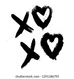 XOXO hand written phrase with hearts isolated on white background with ink spray. Hugs and kisses sign. Grunge brush lettering XO. Easy to edit template for Valentine's day greeting card, poster, etc.