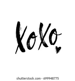Xoxo phrase with sketch heart. Ink lettering design. Grunge brush calligraphy. Romantic background.