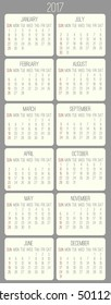 Year 2017 vector monthly calendar. Week starting from Sunday. Beige rounded rectangle over gray background.